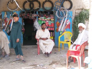 Shopkeepers in Nawa greet Marines
