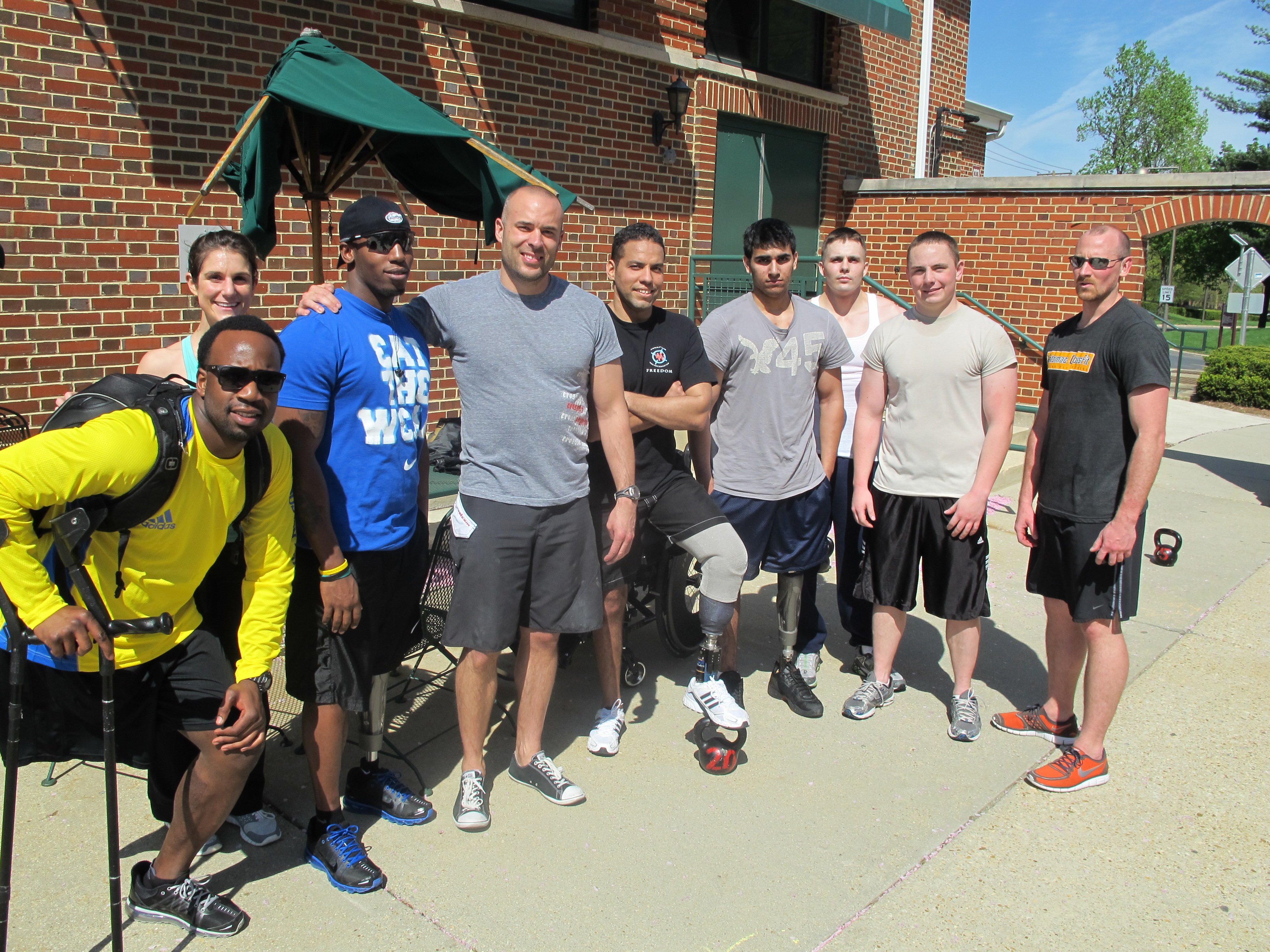 Brian Wilson and Dillon Behr coaching Crossfit at Walter Reed Amputee Center.