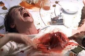 """John Hurt having a bad moment in the 1979 """"Alien"""""""